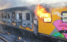 A Metrorail train burns in Woodstock on 22 January 2013. Picture: Supplied