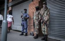 FILE: SANDF members standing outside a Russells furniture shop at Alexandra Plaza amidst threats of a national shutdown on 23 August 2021. Picture: Abigail Javier/Eyewitness News