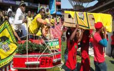 ANC members (L) at the party's final Siyanqoba Rally at the Emirates Airline Park in Johannesburg and EFF members at the party's Tshela Thupa Rally at the Peter Mokaba Stadium in Polokwane. Picture: EWN.