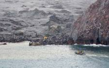 FILE: This handout photo taken and released on 13 December 2019 by the New Zealand Defence Force shows elite soldiers taking part in a mission to retrieve bodies from White Island after the 9 December volcanic eruption, off the coast from Whakatane on the North Island. Picture: AFP.