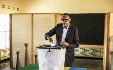 Incumbent Rwandan President Paul Kagame proceeds to cast his vote in Kigali, on 4 August, 2017. Rwandans began voting on 4 August in a presidential election widely expected to return strongman Paul Kagame to office for a third term at the helm of the small east African nation. Picture: AFP.