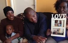 DA leader Mmusi Maimane with the family of slain security guard Frans Mabelane in Marikana, Monday 29 June 2015. Picture: Vumani Mkhize/EWN.