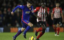 Southamptons Kenyan midfielder Victor Wanyama (R) pressures as Manchester Uniteds Dutch striker Robin van Persie (L) runs with the ball during the English Premier League football match between Southampton and Manchester United at St Marys Stadium in Southampton, southern England on 8 December, 2014. Picture: AFP