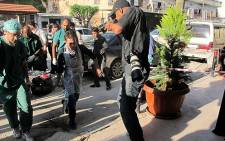 Medical personnel carry in a victim who was wounded during the shelling of a town near Darkoush in Syria on 17 April 2013. Picture: Rahima Essop/EWN
