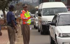 FILE: Johannesburg Metro Police spokesperson Wayne Minnaar directs traffic during an Easter road safety operation in Alexandra, 31 March 2015. Picture: Vumani Mkhize.