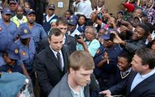 Oscar Pistorius leaves the High Court in Pretoria after the seventh day of his murder trial on 11 March 2014. Picture: Sebabatso Mosamo/EWN.