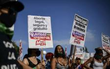 Abortion rights activists demonstrate outside the Congress as senators debate a landmark bill on whether to legalize abortion in Buenos Aires, on December 29, 2020. Picture: AFP.