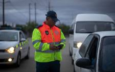 A Western Cape traffic official conducts vehicle checks and random breath testing operations. Picture: @WCGovSafelyHome/Twitter.