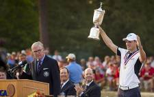 German Martin Kaymer holds the 2014 US Open trophy aloft. Picture: Facebook.com