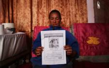 Juanita Pieters hold up a flyer with her daughter, Courtney Pieters picture on it. Picture: Bertram Malgas/EWN.