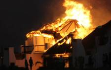 Houses ablaze in St Francis Bay on 11 November 2012. Picture: Supplied