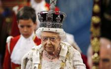 FILE: Britain's Queen Elizabeth II, wearing the Imperial State Crown, proceeds through the Royal Gallery during the State Opening of Parliament at the Palace of Westminster in central London on 27 May 2015. Picture: AFP.