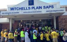 Mitchells Plain residents gather at the area's police station before embarking on a march against gangsterism and drugs on Saturday 12 April 2014. Picture: Mia Spies/EWN.