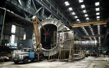 FILE. Work continues on a nuclear reactor vessel inside a factory in Volgodonsk, south of Moscow. Picture: Alex Eliseev/EWN