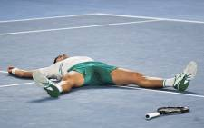 Serbia's Novak Djokovic celebrates winning against Russia's Daniil Medvedev during their men's singles final match on day fourteen of the Australian Open tennis tournament in Melbourne on February 21, 2021. Picture: William West / AFP.