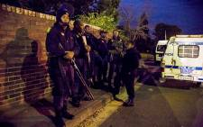 Saps Public Order Police stand watch near the male residences where violence was heaviest at Fort Hare. Picture: Thomas Holder/EWN.