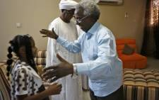 Osman Mirghani (R), editor-in-chief of independent daily Al-Tayar, is greeted by relatives following his release from jail at his home in the Sudanese capital Khartoum's twin city of Omdurman, on 29 March 2019. Picture: AFP