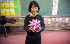 Origami For Africa's founder Kyoko Kimura Morgan poses with one of her origami creations. Picture: Anthony Molyneaux/EWN