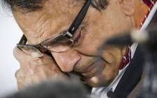 Anni Dewani's father Vinod Hindocha wipes away the tears as the family delivered a final media statement ahead of the start of Shrien Dewani's trial on 5 October 2014. Picture: Thomas Holder/EWN