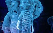 A YouTube screengrab shows a hologram of an elephant.
