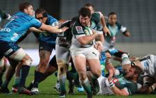 Bulls' Marco van Staden runs with the ball during the Super Rugby match between New Zealand's Auckland Blues and South Africa's Northern Bulls at Eden Park in Auckland on 31 May 2019. Picture: AFP