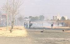 Residents in Kagiso clash with police during a service delivery protest on 31 July, 2012. Picture: Chirsta Van der Walt/Eyewitness News