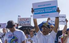 "Activists shout chants during the ""End Family Detention,"" event held at the Tornillo Port of Entry in Tornillo, Texas on 24 June 2018. Picture: AFP."