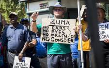 FILE: A member of the public unhappy with President Jacob Zuma's Cabinet reshuffle holds up a placard at a public gathering organised by the Save SA campaign. Picture: Reinart Toerien/EWN.