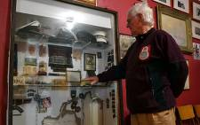Les Gale shows the damage to the Moths display cabinet at the Simon's Town Museum