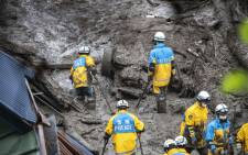 Police search for missing people at the scene of a landslide following days of heavy rain in Atami in Shizuoka Prefecture on July 4, 2021. Picture: Charly Triballeau / AFP