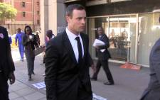 Oscar Pistorius makes his way to the high court chambers after day 38 of his murder trial. Picture: Reinart Toerien/EWN