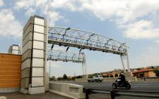 A motorist uses the N12 highway, a proposed toll road in Johannesburg, on 15 November 2012. Picture: Sapa.