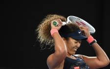 Japan's Naomi Osaka celebrates winning against Jennifer Brady of the US during their women's singles final match on day thirteen of the Australian Open tennis tournament in Melbourne on February 20, 2021. Picture: AFP