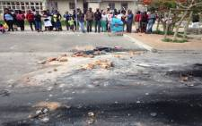 Residents gather at the scene in Masiphumelele but are tight lipped about the alleged mob attack. Picture: Lauren Isaacs/EWN.