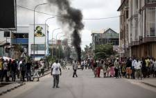 FILE: People look on as protesters burn tyres during a demonstration calling for the President of the Democratic Republic of the Congo (DRC)to step down on 21 January, 2018 in Kinshasa. Picture: AFP