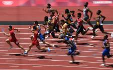 Athletes compete in the men's 4x100m relay heats during the Tokyo 2020 Olympic Games at the Olympic Stadium in Tokyo on 5 August 2021. Picture: Ina Fassbender/AFP
