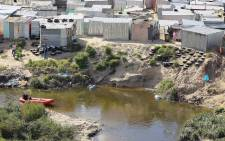 A search is still under way for four missing youths, whose bodies were apparently thrown into a river that runs through an informal settlement in Driftsands. Picture: SAPS.