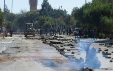 Khumalo Street was strewn with debris after scores of angry protesters took to the streets in Orlando West, in Soweto to protest against Eskom's prepaid meters. Picture: Louise McAuliffe/EWN.