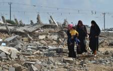Egyptian women walk through rubble of houses destroyed by Egyptian security forces near the border with the Gaza Strip, in Rafah, Egypt, on 5 November 2014. Egyptian authorities have evacuated and demolished over 800 houses belonging to 1,165 families in North Sinai along the border with the Palestinian Gaza Strip in order to create a security buffer zone. Picture: EPA.