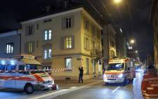 Ambulance and police cars are seen outside a Muslim prayer hall, central Zurich, on 19 December, 2016, after three people were injured by gunfire. Picture: AFP.