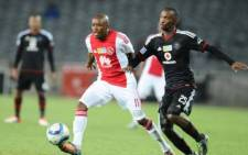 Orlando Pirates' Thabo Rakhale fights for the ball during their MTN8 clash against Ajax Cape Town at Orlando Stadium on 4 August 2015. Picture: PSL.