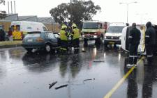 Officials on scene where a woman was killed after her car collided with a minibus taxi in Cape Town on 25 October 2017. Picture: Supplied.