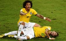 Defender Marcelo shouts for help after Brazil's forward Neymar was injured during the quarter-final football match between Brazil and Colombia at the Castelao Stadium in Fortaleza during the 2014 FIFA World Cup on 4 July. Picture: AFP.