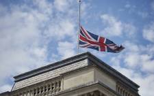 FILE: Britain's Union flag flies at half-mast above the Foreign and Commonwealth Office (FCO) in central London, on 28 June 2015, in memory of those killed after the mass shooting in Tunisia on Friday that left 38 people dead including at least 15 Britons. Picture: AFP.