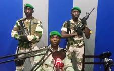 "A screengrab of Gabon soldiers on state radio on 7 January 2019 calling on the people to ""rise up"" and announced a ""national restoration council"" would be formed, as an ailing President Ali Bongo is out of the country. Picture: AFP"