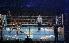 Cameroon-born Carlos Takam (L) defends against Britain's Anthony Joshua (R) during their world heavyweight title fight at The Principality Stadium in Cardiff on 28 October 2017. Picture: AFP
