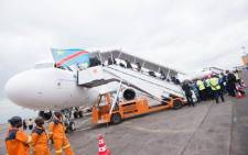 FILE: Passengers board the maiden flight of Congo Airways on 09 October 2015 from the International Airport in Kinshasa. Picture: AFP