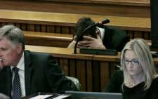 Oscar Pistorius reacts at the High Court in Pretoria during his trial. Picture: Pool.