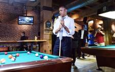 US President Barack Obama playing a game of pool at a pub in Denver, Colorado, on 8 July. Picture: AFP.