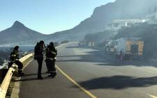 Firefighters worked through the night amid a vegetation fire between Camps Bay and Llandudno. Picture: Monique Mortlock/EWN.